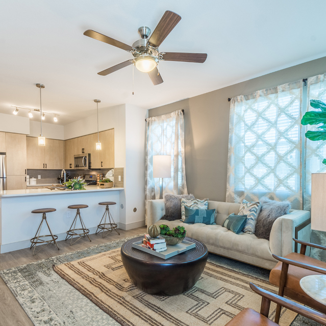 The Braydon - Stylish Living Area With Accent Wall And Ceiling Fan