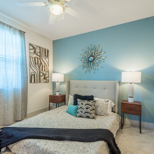 The Braydon - Cozy Bedroom With White Interior Design, Window And Ceiling Fan