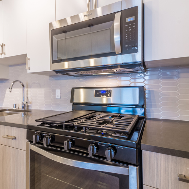 The Braydon - Fully Equipped Kitchen With White Upper And Lower Wood Grain Cabinets With Stainless Steel Appliances